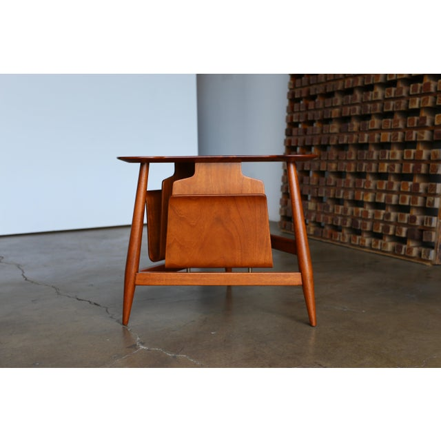 Edward Wormley Magazine Table Model 5313. Manufactured by Dunbar Circa 1953. This table retains the original Dunbar tag to...
