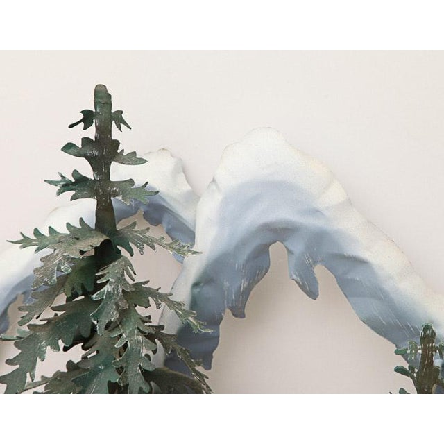A fabulous metal wall sculpture of a woodland scene. It features three-dimensional painted metal cutouts that depict...