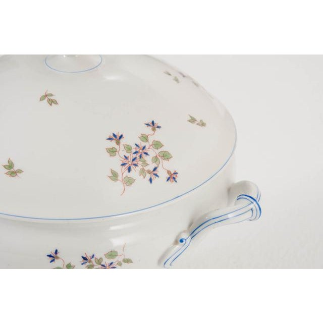 A sweet Old Paris tureen dating to the early 1900's. The soup vessel has a beautiful Cornflower pattern and is in...