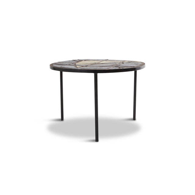 French mosaic cocktail table, made circa 1950. A modern black steel frame supporting a colourful mosaic inlay. Designer...