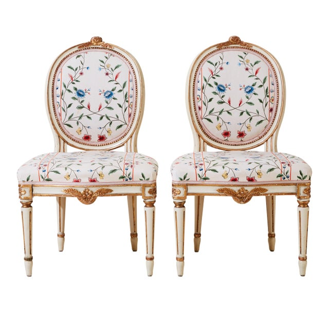 A pair of Gustavian carved chairs with original paint and gilding. Dating from the first half of the 1900's. Very good...