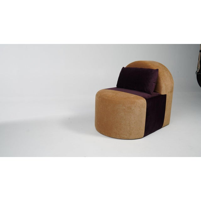 A side chair that offer comfort and elegance. Upholstery in Caramel and Deep Space Purple velvet.