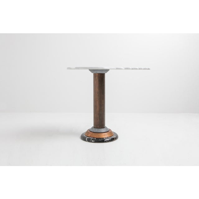 Postmodern angelical occasional table in marble, stone and copper. Great eclectic chic piece in marble in a much more...