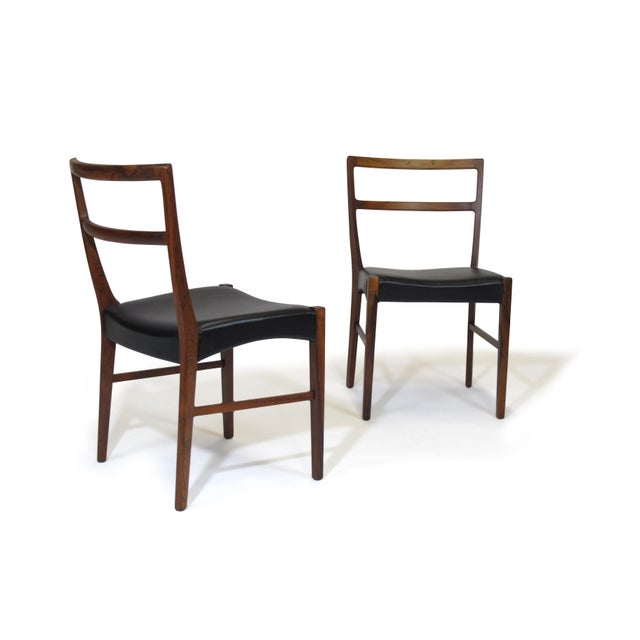 Minimal and classic form dining chairs designed by Johannes Andersen, handcrafted by Bernhard Pedersen Sons, Denmark in...