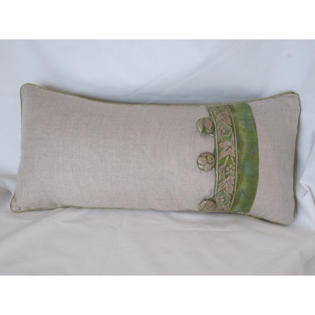 A Pillow made from a Fortuny fabric, backed with Belgian linen and trimmed with a Fortuny border motif, a down insert is...