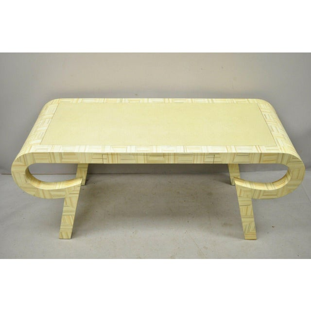 Allesandro for Baker Karl Springer style cream lacquer sculptural desk console table. Item features dramatic form,...
