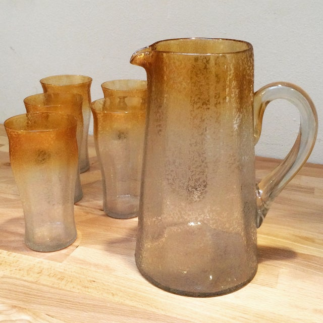 This crackle glass set is the perfect warm-weather accessory for your bar. It features a pitcher and 6 glasses, ideal for...