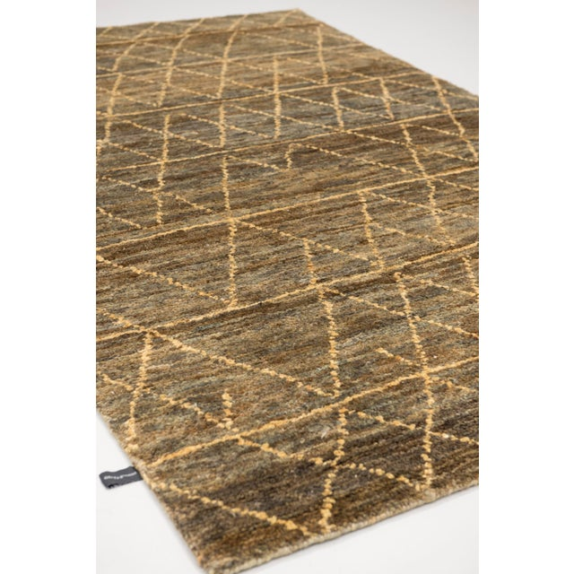 Color: Brown - Made In: India. 100% Jute. A contemporary Moroccan style design woven in a plant based fiber giving it and...