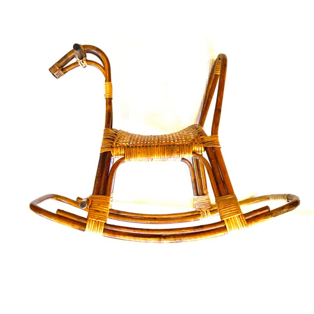 Vintage Franco Albini style rattan rocking horse, perfect for outfitting a nursery. Very sturdy. Excellent condition with...