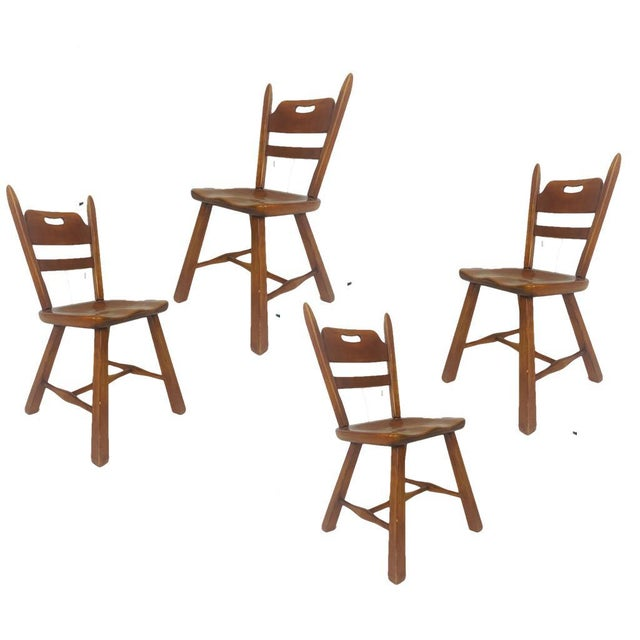 Set of 6 Vermont rock maple dining chairs designed by Herman DeVries for Cushman. Measures: armchairs: H 34 in. x W 22.75...