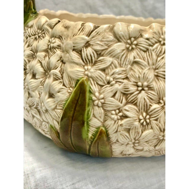 Beautiful vintage ceramic floral basket. Featuring an abundance of white flowers with accents of green and brown. Very...