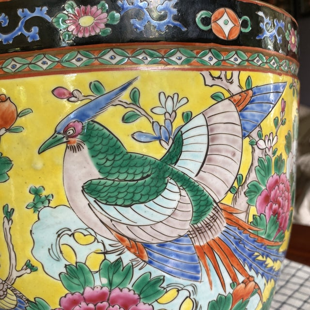 Japanese monumental fish bowl planter with yellow ground and multi-colored peonies, birds and leaves. Marked Nippon. Circa...