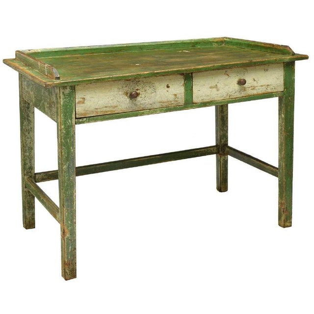 This fabulous and unique, one-of-a-kind Scandinavian pine work table was made in the early 20th century. The now in worn...