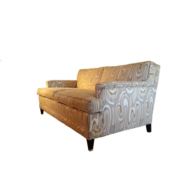 Louis XVI love seat featuring a classic Maison Jansen style. It is upholstered in a natural-tone fabric that showcases a...