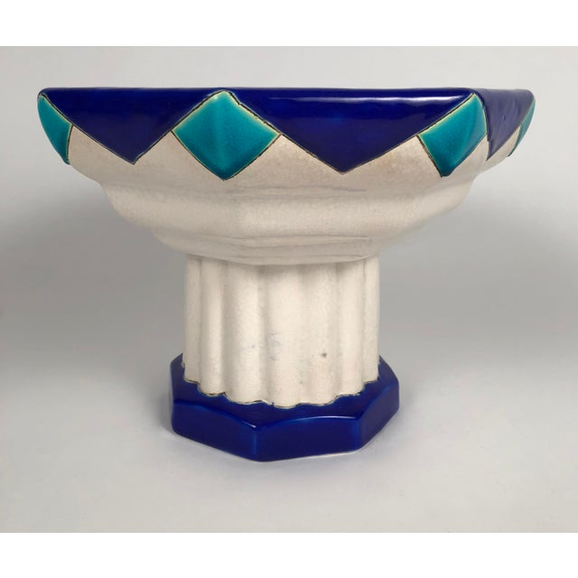 An Art Deco period ceramic footed octagonal compote by Boch Freres in blue and turquoise enamels. Signed and numbered on...