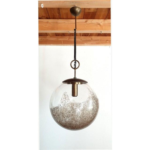 Large Murano glass ball pendant light, by Carlo Nason for Mazzega, Italy, 1960s. Mid Century Modern A brown irregular...