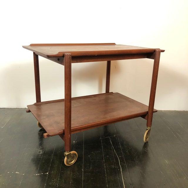 Wonderful early 1960s Danish Teak Server/Bar Cart designed by Poul Hundevad for Vandrup Mobler. Brilliant design allows...