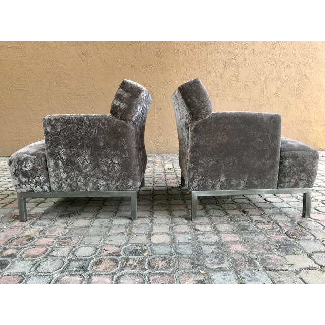 A pair of modern vintage Carlyle lounge arm chairs by Krug furniture. These are strong and well built arm chairs sitting...