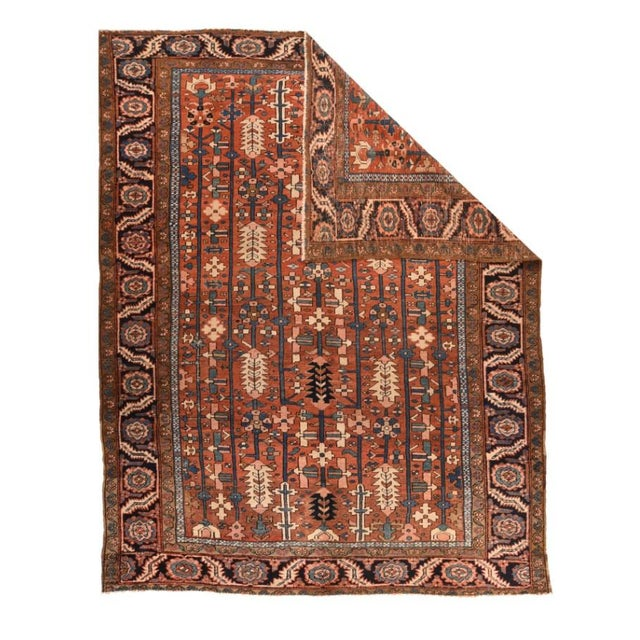"""Antique Hand Made Heriz Persian Rug 8' 6"""" x 10' 11"""" Made of wool in a rust color."""