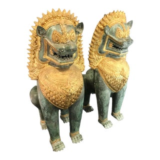 Vintage Mid Century Verdigris and Gilt Bronze Temple Foo Dog Statues- A Pair For Sale