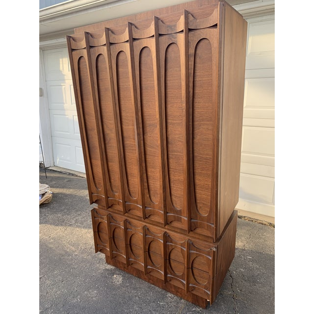 Two piece Canadian walnut armoire. Bottom piece features 2 large drawers and has a finished top that could be used...
