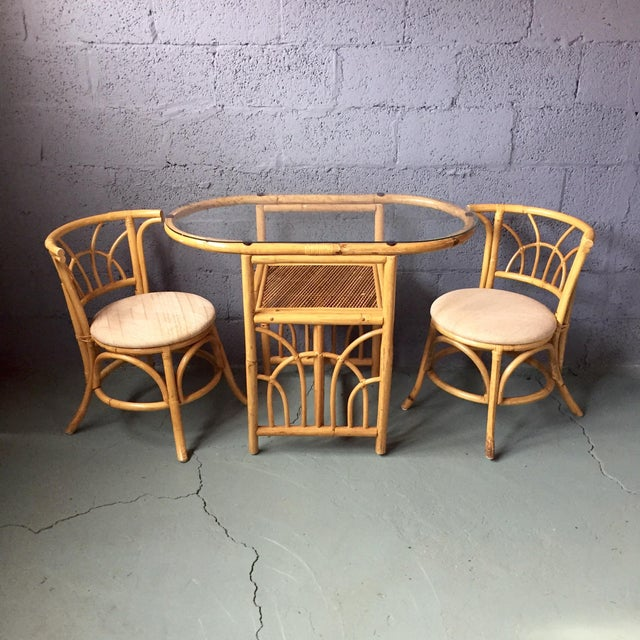 Perfect little vintage bamboo table and chair set. This set is very pretty and compact because the chairs tuck completely...