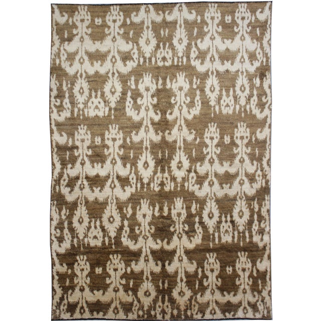 Beautiful handmade Ikat rug. Floral design woven in by Aara Rug hands. This rug is made of 75% wool and 25% cotton. This...