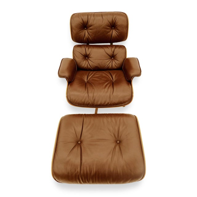 Eames for Herman Miller Rosewood Lounge Chair & Ottoman. A vintage 670 & 671 set with brown leather cushions. Chair...