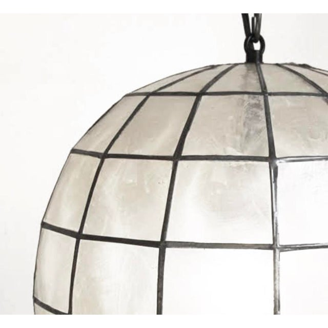 Stunning contemporary globe lantern made from delicate Capiz shell square pattern bonded together with pewter finish...