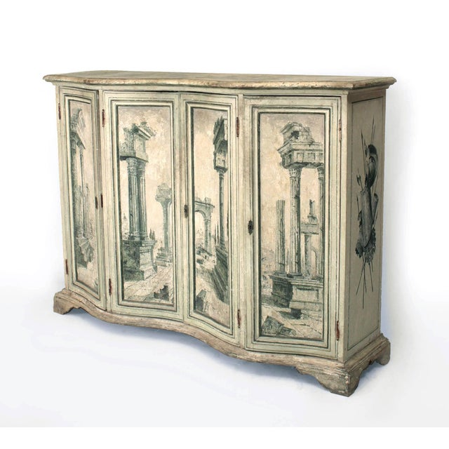 Pair of Italian neoclassic (18/19th century) grisaille painted commodes with a serpentine shape and four doors decorated...