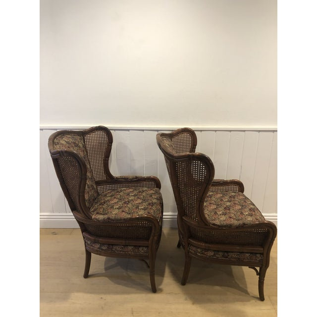 Amazing condition vintage Ethan Allen Chairs. No breaks in the caning. Fabric in mint condition. These were in THAT room...