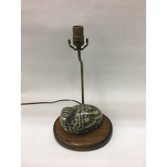 This unique lamp features a multi-colored porcelain quail nesting at the base. Quail also doubles as holder for your...