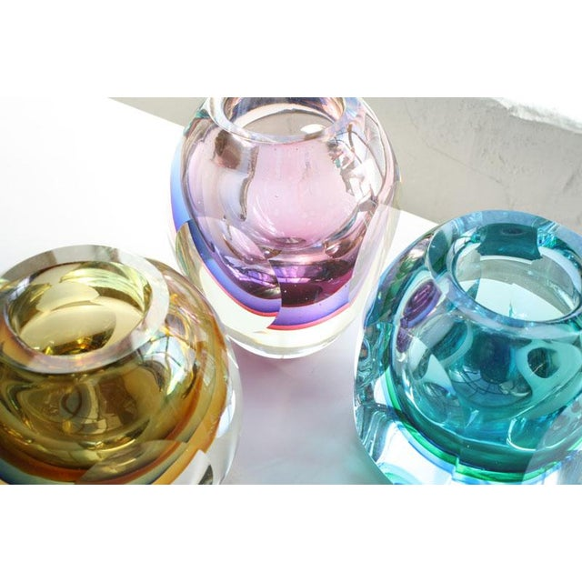 """Set of 3 Faceted Murano Sommerso Glass Vases. Violet, blue and yellow colors. Violet measures 4""""W x 4""""D x 5.25""""H. Blue..."""