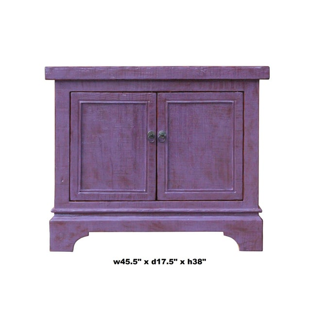 This is a low console cabinet made of rustic raw rough wood in the distressed purple lacquer finish. It can be a credenza,...