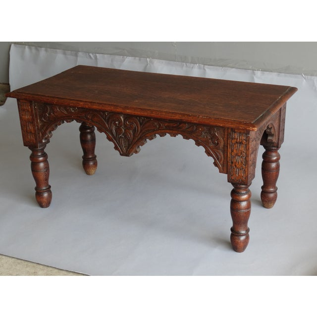 Antique French oak bench with hand turned legs and carved apron. Circa 1920, it has a lovely hand carved apron on all...