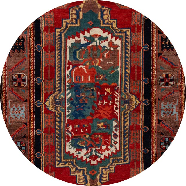 Vintage hand-knotted wool rug with a red field, and multicolor accents in an all-over geometric design. This rug measures:...
