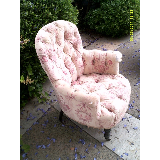 This is a very old French Victorian Tufted chair. ..the fabric is shabby and may require reupholstering or slip covering...