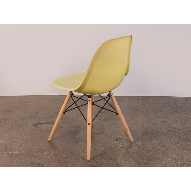 Priced per individual chair. We have a group of canary yellow fiberglass shell chairs by Charles and Ray Eames for Herman...