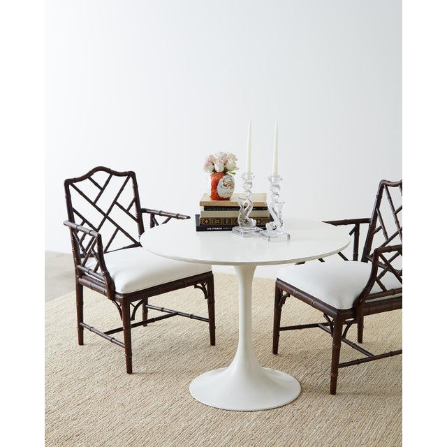 Glorious set of six faux bamboo dining chairs or armchairs featuring a dark chocolate lacquered finish. Made in the...