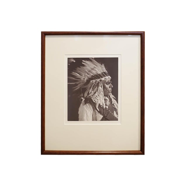 Early 20th century set of three photographs depicting Sioux Native Americans, one wearing glasses, and one self portrait...