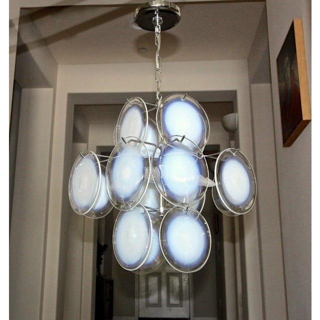 Vistosi Italian clear and opalescent hand blown glass disc four-light chandelier or pendant hanging light. The glass disks...