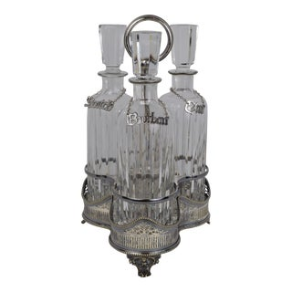Late 19th Century Three Bottle Decanter Set in Silverplate Holder For Sale