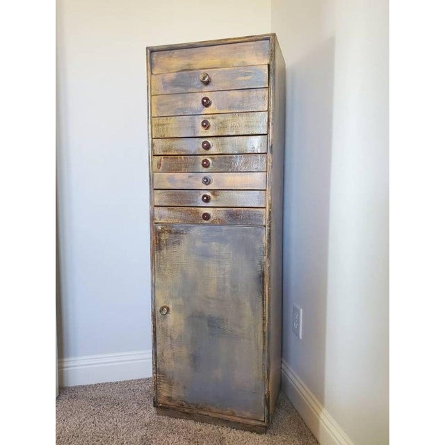 Antique industrial factory office multi-drawer lightweight wooden filing cabinet from the early 20th century. Distressed...