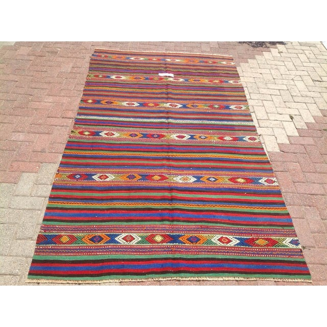 This beautiful, vintage, handwoven kilim is approximately 50 years old. It is handmade, of very fine quality wool in all...