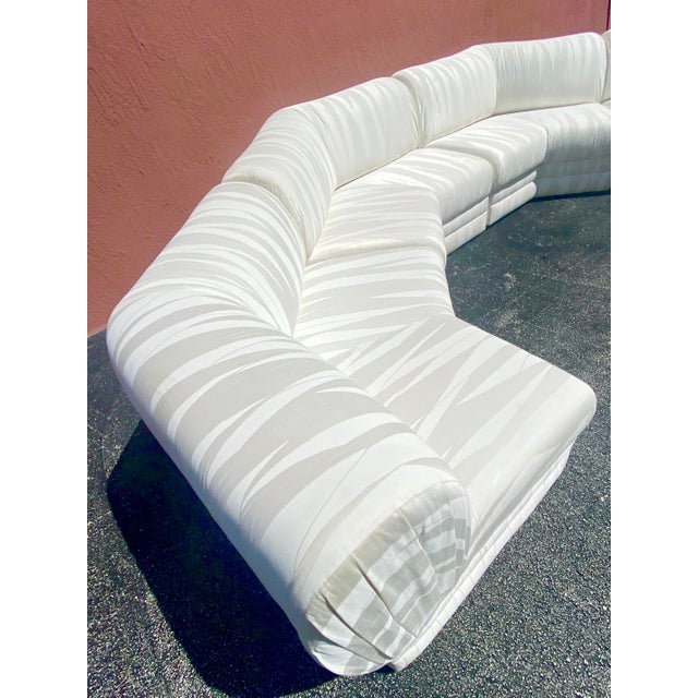 Exceptional Milo Baughman sectional sofa. Produced by the Thayer Coggin company. Beautiful wrap around sofa done in a...