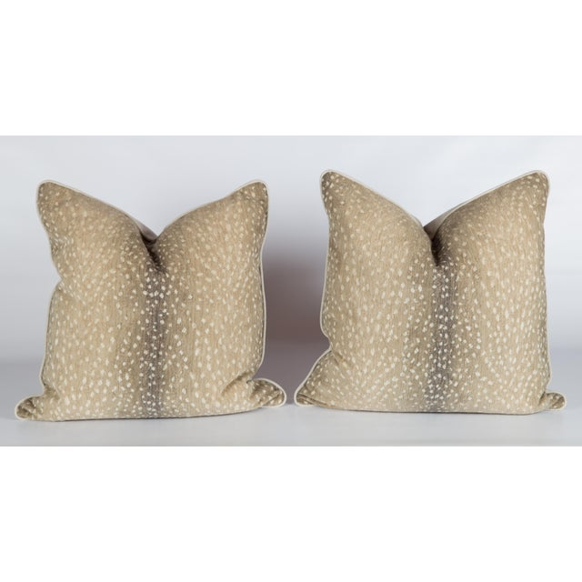 Pair of custom taupe-and-ivory linen-and-cotton chenille antelope pattern fabric pillows. Solid ivory linen backs and...