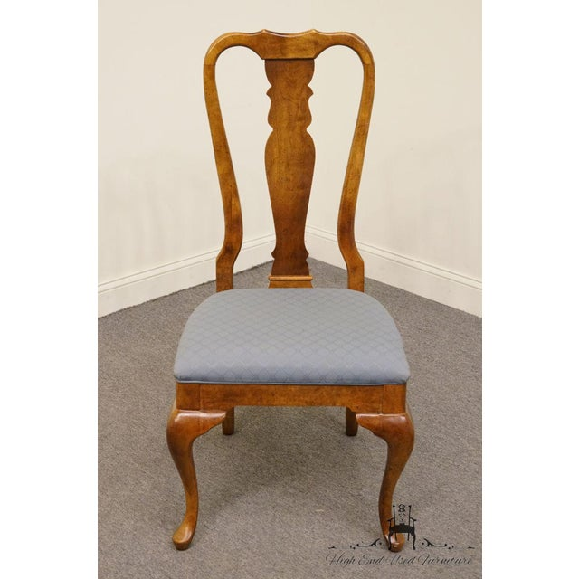 This is a vintage American of Martinsville dining chair from the late 20th century. The piece is made of solid cherry.