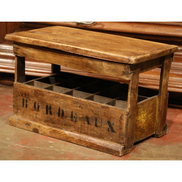 This interesting wooden wine or champagne bottle holder was crafted in France, circa 1920. The useful cabinet, made with...