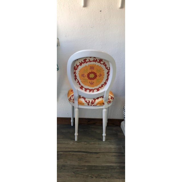 Classic Louis XV style round back side chair. Seat and rear chair panels are upholstered in bold, large scale linen...