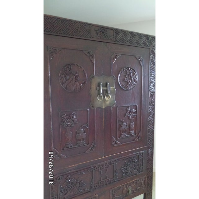 A One of a Kind Visit to Antiquity via Mainland China! Offering a Chinese mixed wood two-door clothing chest with...